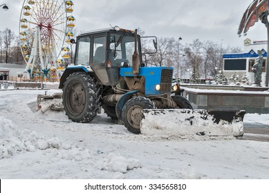 Tyumen, Russia - November 29, 2008: Tractor with snowplowing equipment cleans street in snowstorm weather