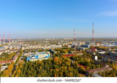 Tyumen, Russia - September 27, 2016: Gymnasium No. 16 and the School park against TV towers on background
