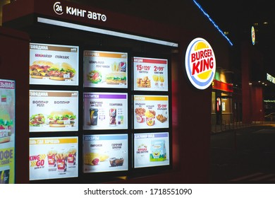 Tyumen, Russia-March 19, 2020: Burger King restaurant at twighlight and trademark logo.