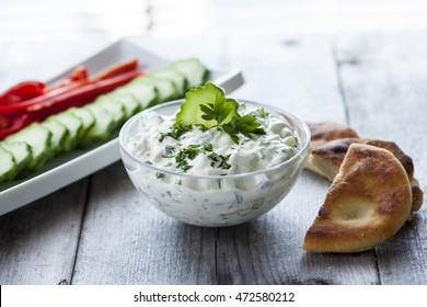 Tzatziki sauce with vegetable and pita bread