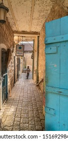 Tzfat/Israel - August 11, 2017: Hasidic boy runs down an alleyway in the old city of Tzfat (Safad)