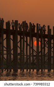the u bein bridge in Amarapura near the City of Mandalay in Myanmar in Southeastasia, yanmar,  mandalay, april, 2015..