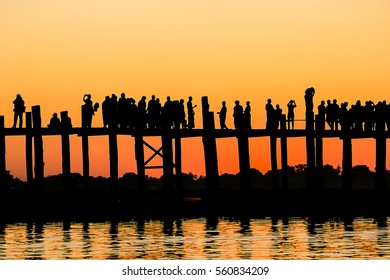 U Bein Brige,Mandalay,Myanmar,13 November,2016.silhouette and orange tone picture of U Bein bridge,the longest teak briged of the world and one place of famous landmark to tourist at Myanmar