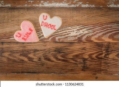 U Rule and U Drool Heart Cookie over wooden copy space