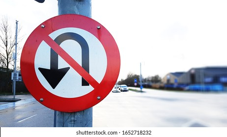 U turn prohibited sign in a traffic light with busy roads - Shutterstock ID 1652718232