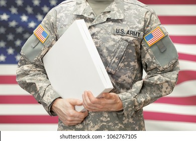 U.A. Army soldier holding big white box with two hands