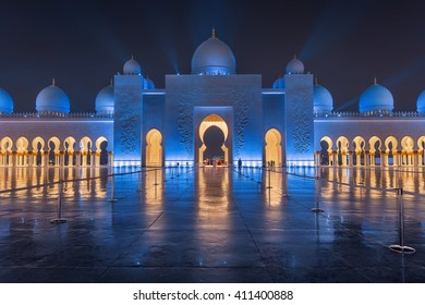 UAE, Abudhabi, August 6, 2015 Sheikh Zayed Grand Mosque at Night Covered with Beautiful Blue Lights and light rays