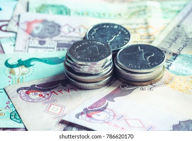 UAE dirham currency notes and coins.