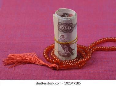 An UAE Dirhams and islamic rosary