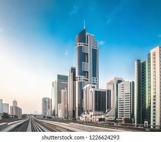 UAE, Dubai - 16 OCTOBER 2018: Sheikh Zayed Road, Blue Tower Building - DIRE. Dubai city. Skyscrapers at sunrise in Dubai. Editorial photo.