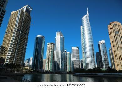 UAE, DUBAI, FEBRUARY 5, 2016: Almas Tower supertall skyscraper and Jumeirah Lakes Towers, Dubai multi commodities centre, United Arab Emirates. Dubai is a city and emirate in United Arab Emirates