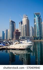 UAE, DUBAI - JANUARY 17, 2017: Moored yacht against the background of skyscrapers, Marina Walk