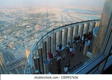 UAE, DUBAI, JANUARY 31, 2016: People on observation deck on 124 floor inside Burj Khalifa megatall skyscraper in Dubai, United Arab Emirates