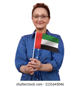 UAE flag. Woman holding the United Arab Emirates flag. Selective focus on the flag.