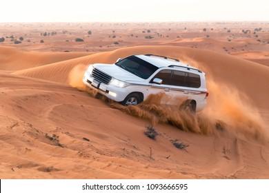 UAE, Fujairah 2017.19.11 Off-road safari on jeeps SUVs in the Arab orange-red sands desert in the sunset sun