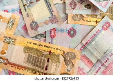 UAE national currency, top view of mixed dirhams banknotes. Money banknotes.