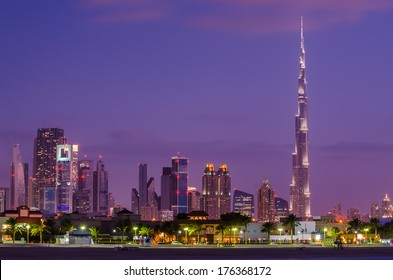 UAE, The United Arab Emirates: Downtown Dubai at violet spectacular nice sunset. Burj Khalifa, the tallest building in world.  Amazing beautiful modern skyscrapers  built in desert. Skyline from beach