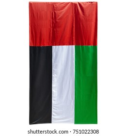 UAE United Arab Emirates Flag. Real photo of large vertical UAE flag isolated on white.
