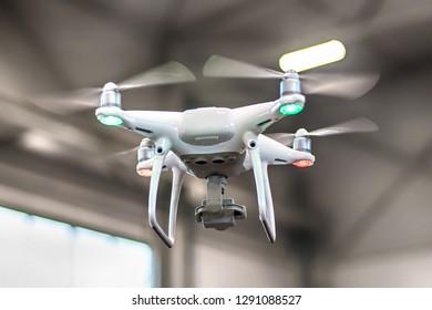 Uav drone copter flying with high resolution digital camera. Close up