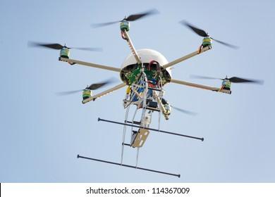 uav drone hexarotor flying in blue sky