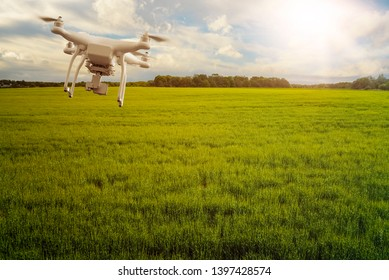 UAV drone multicopter flying with high resolution digital camera over a crops field, agriculture concept