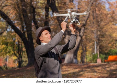The UAV drone and photographer man hands close-up.drone copter flying with digital camera. Flying camera take a photo and video.