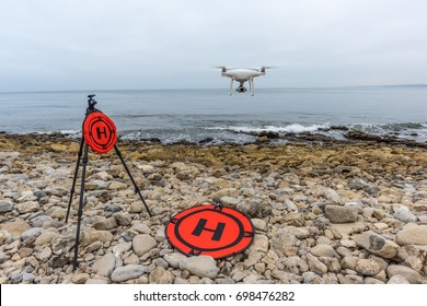 UAV, Quadcopter flying at beach with landing pad