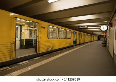 U-Bahn station in Berlin undeground tube. Platform and train.