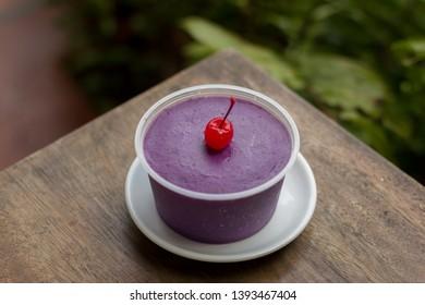 ube purple yam dessert with cherry on top