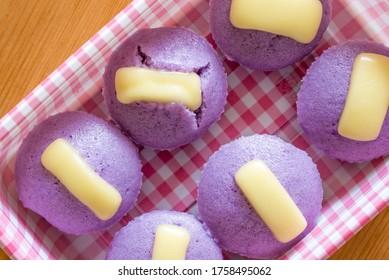 Ube puto with cheese.A Filipino style rice cupcake muffin with ube purple yam flavor.