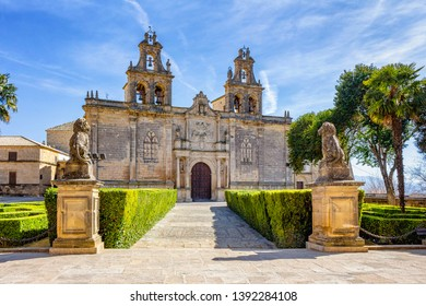 Ubeda, Andalusia, Spain - March 2018: View of the facade of the Basilica and Royal Collegiate Church of Santa Maria from the center of the Vazquez de Molina square.