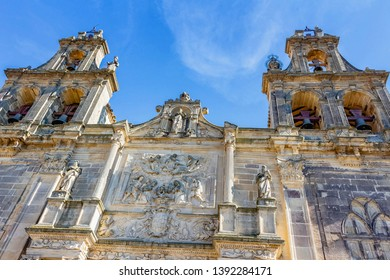 Ubeda, Andalusia, Spain - March 2018: View of the towers of the bells of the Basilica and Royal Collegiate Church of Santa Maria