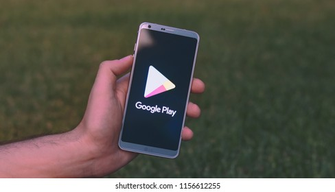 Ubeda, Spain - August 11, 2018: Holding a LG G6 Android smartphone on hand with Google Play logo on screen