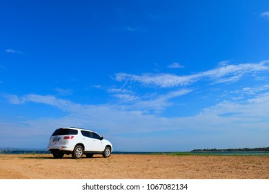 Ubon Ratchathani, Thailand - April 12, 2018: Private test vehicle,   White Trailblazer Chevrolet ,Picture on the sand floor,  the Lakeside, On blue sky background, Thailand.