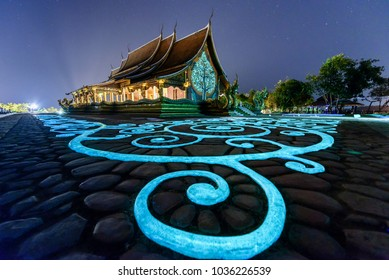 UBON RATCHATHANI, THAILAND- February 18, 2017: The lightning from fluorescent color in the evening at Sirindhorn Wararam, the temple in Ubon Ratchathani, Thailand