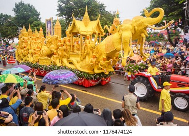 Ubon Ratchathani, Thailand - July 28, 2018: A lot of tourists were watching wax candle procession of Sri Pradu temple which was the winner of imprinted candle.