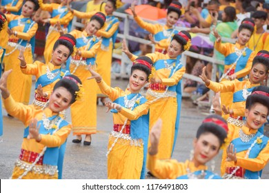 Ubon Ratchathani, Thailand - July 28, 2018: A lot of tourists were watching Thai folk dancers in wax candle procession.