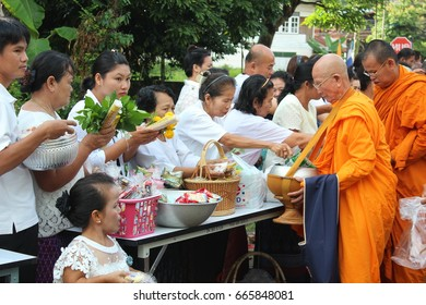 Ubon ratchathani, Thailand – June 25, 2017: Asian peoples organizes charity activities to inherit traditions in buddhism at Ubon Ratchathani, Thailand
