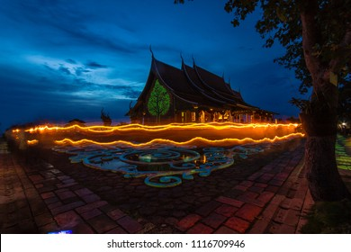 UBON RATCHATHANI,THAILAND - MAY 29,2018 : a Buddhist ceremony where people walk with lighted candles in hand around a temple in vesak day