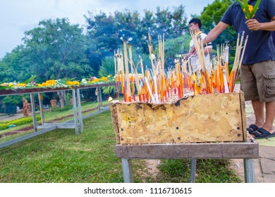 UBON RATCHATHANI,THAILAND - MAY 29,2018 : Buddhist ceremony where people walk with lighted candles in hand around a temple in vesak day
