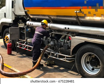 UBONRATCHATANI JULY 9: Technician is releasing fuel oil from trucks into underground storage tanks in petrol station, Muang District  Ubonratchathani  Province,  Thailand  on July 9, 2017.