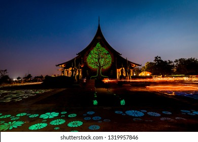 Ubonratchatani, Wat Phu Praw Thailand - February 19, 2019: The special day of Buddhism Makha Bucha day or Vesak Day. A Buddhist ceremony where people walk with lighted candles in hand around a temple.