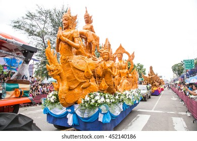 UBONRATCHATHANI, THAILAND - JULY 12: Candle wax carving Thai style in the traditional parade active festival Buddhist Lent on July 12, 2014, UbonRatchathani, Thailand