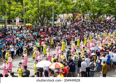 UBONRATCHATHANI, THAILAND - JULY 12: Thai tourists and foreigners are appreciated candle procession in Candle festival (Ubon Candle Festival 2014) on July 12, 2014, UbonRatchathani, Thailand