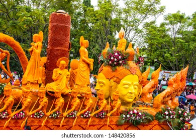 UBONRATCHATHANI, THAILAND - JULY 23: Candles are carved out of wax, Thai art form of wax(Ubon Candle Festival 2013) on July 23, 2013, UbonRatchathani, Thailand
