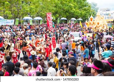 UBONRATCHATHANI, THAILAND - JULY 23: Many people watch beautiful girl dance in Candle Festival (Ubon Candle Festival 2013) on July 23, 2013, UbonRatchathani, Thailand