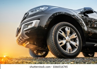 Ubonratchathani, Thailand-April 10, 2018: FORD SUV car front of FORD off-road, on the rock with morning time sunrine