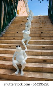 """UBUD, BALI - AUGUST 28, 2016: Fancy frogs are sitting on the stairs in """"City of Masters"""""""