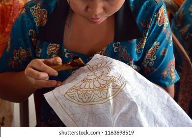 Ubud, Bali / Indonesia - 03202017 : Batik Textile Making in Bali Indonesia.  Batik painting and drawing.