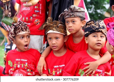 UBUD, BALI, INDONESIA - 11 March.  Young boys celebrate Nyepi New Years Eve party (ogoh-ogoh) in traditional and colorful costumes with batik headscarf, religious rituals on March 11, 2013 in Ubud.
